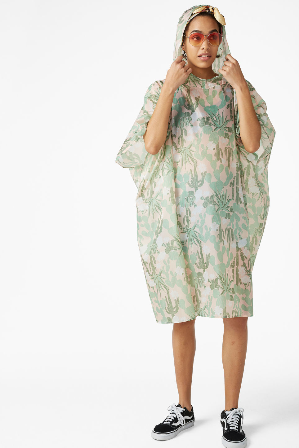 Model front image of Monki foldable poncho in green
