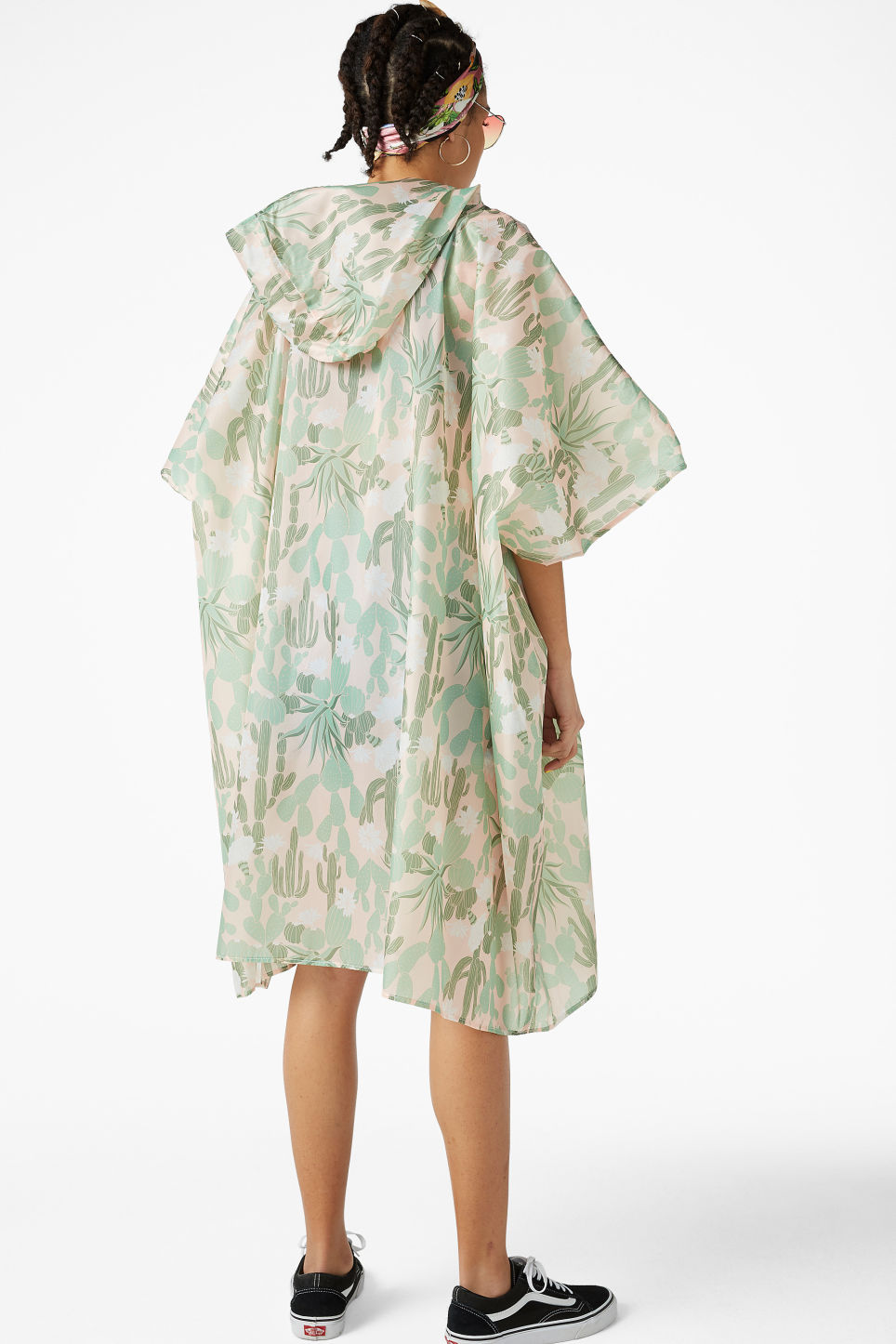 Model back image of Monki foldable poncho in green