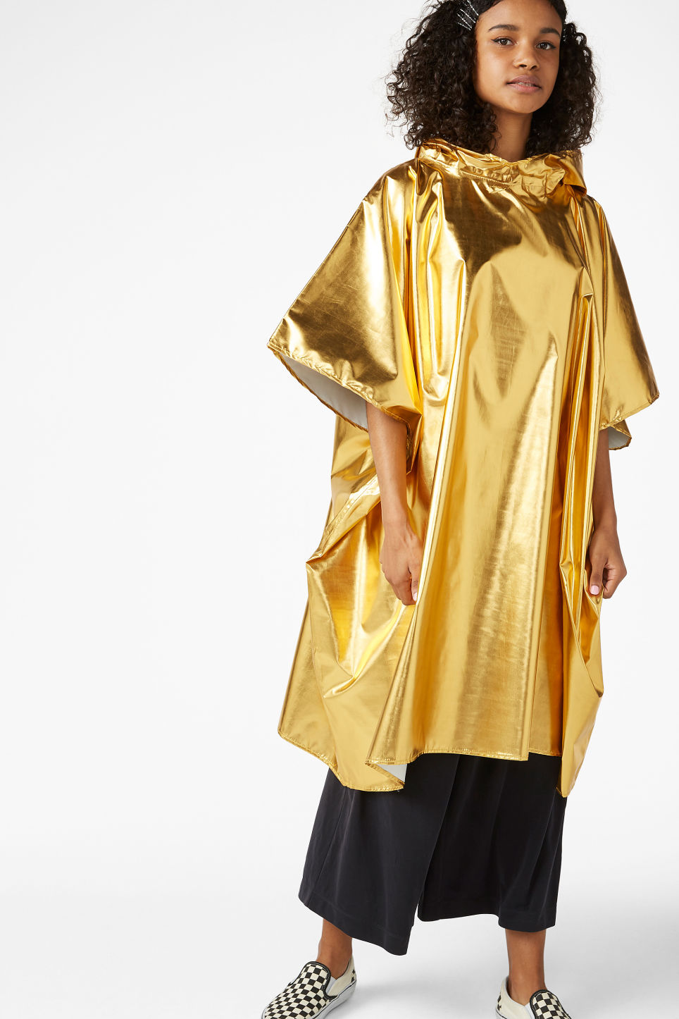 Model front image of Monki foldable poncho in gold