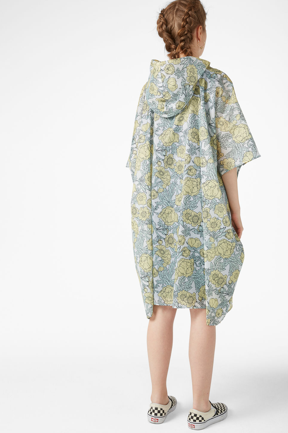 Model back image of Monki foldable poncho in yellow