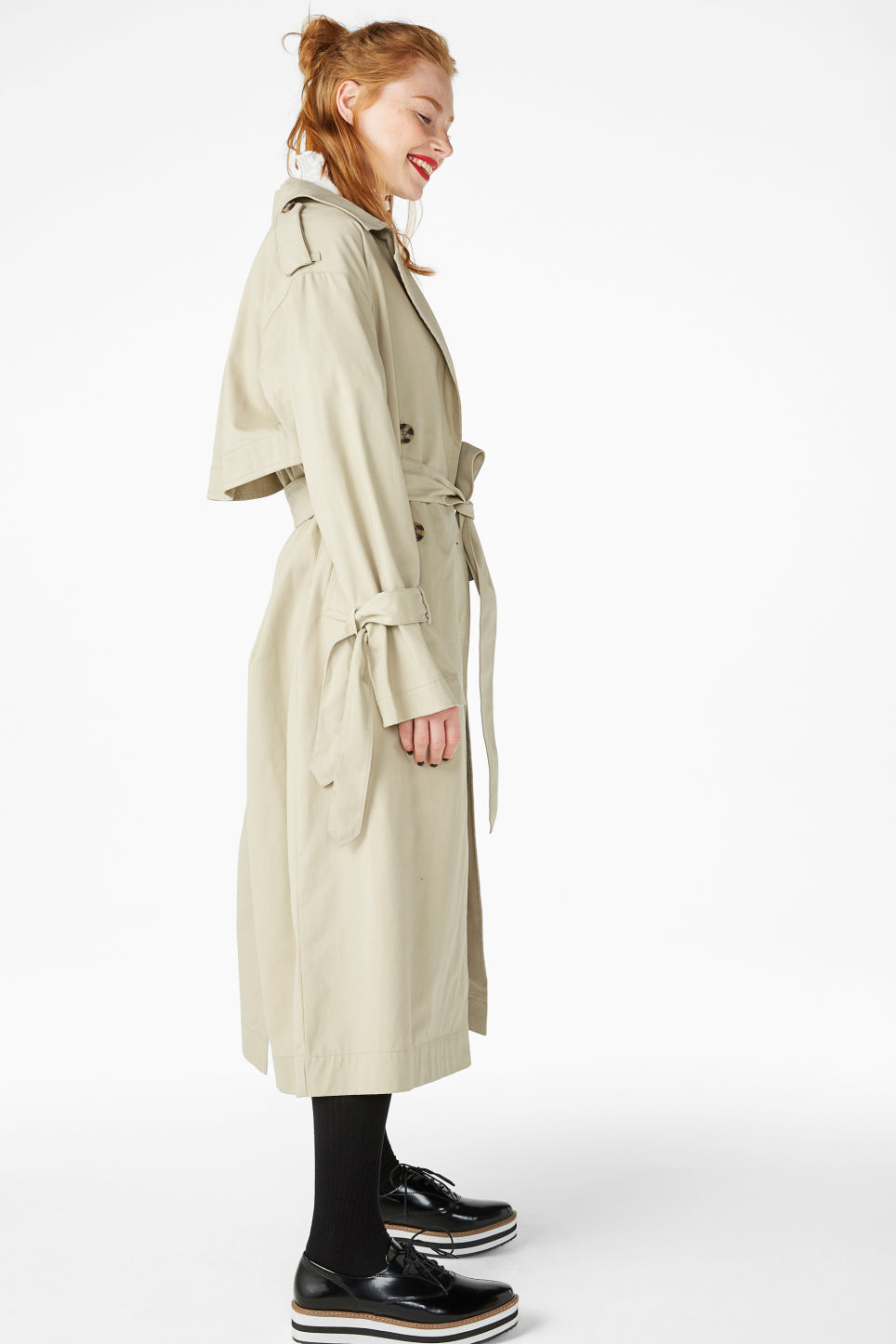 Model side image of Monki classic trench coat in beige
