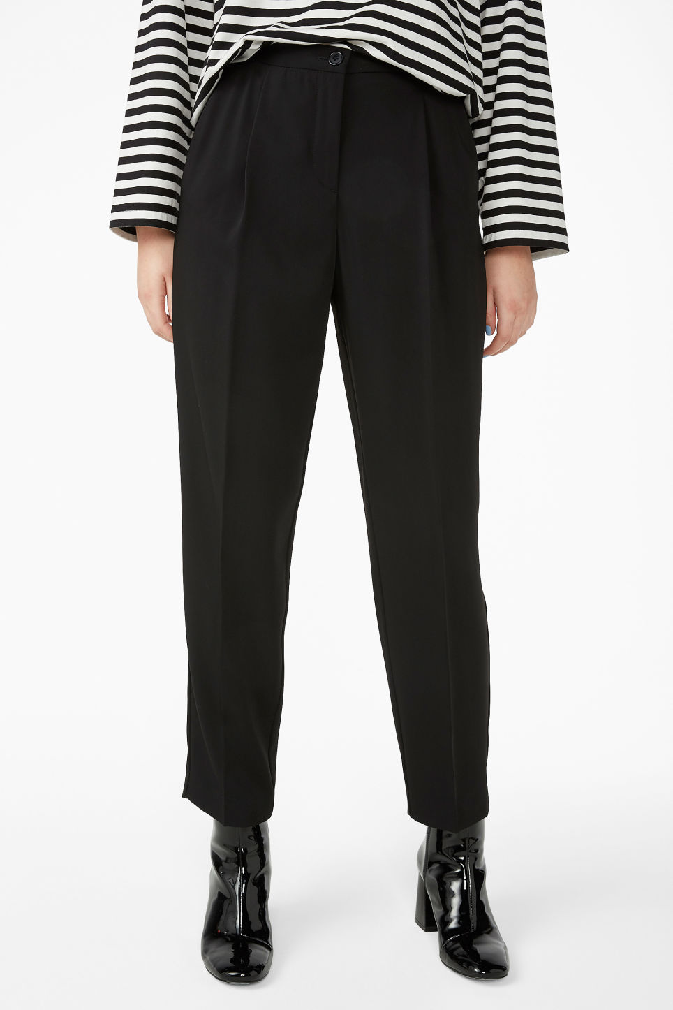 Model side image of Monki dressy tapered trousers in black