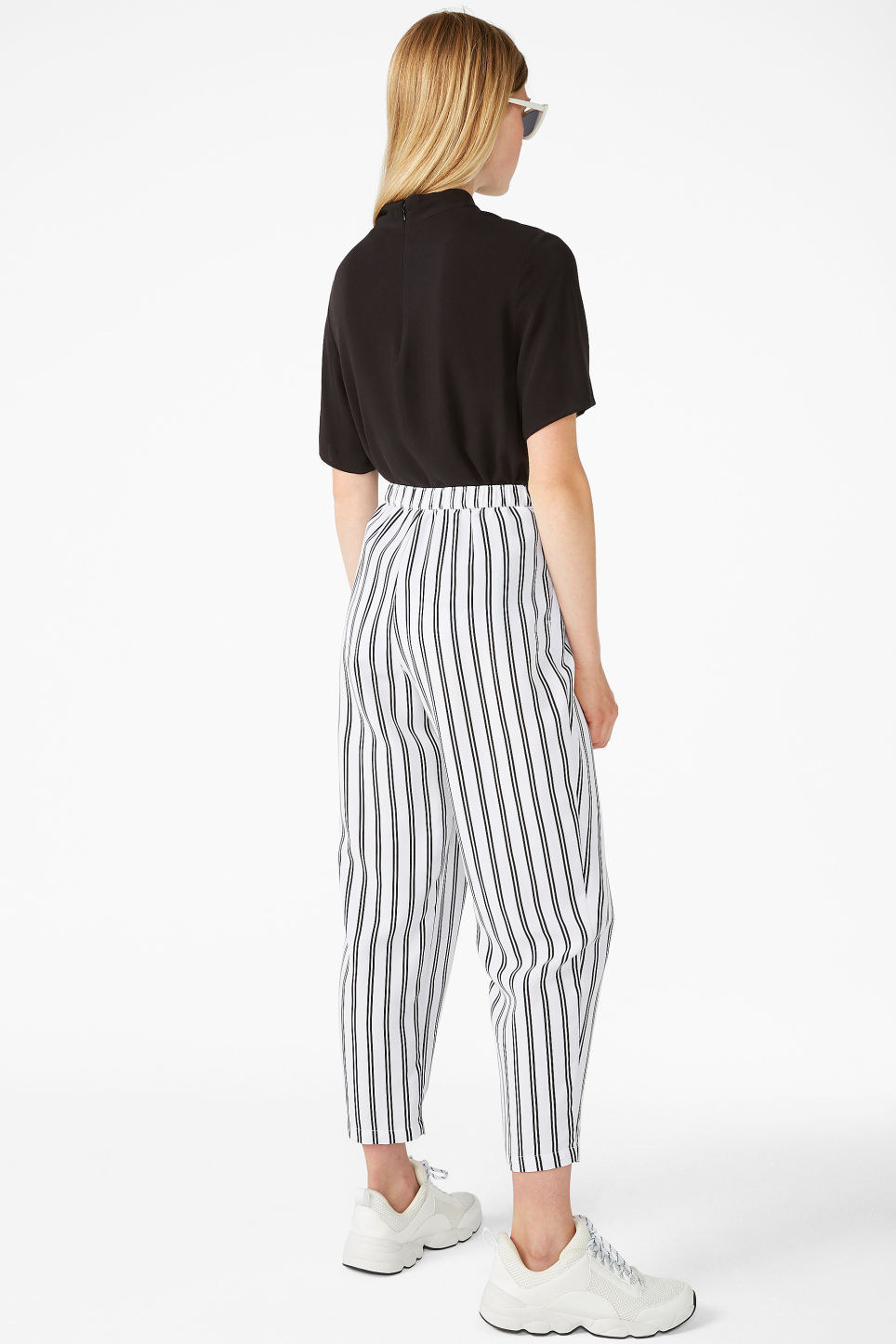 Model back image of Monki flowy trousers in white