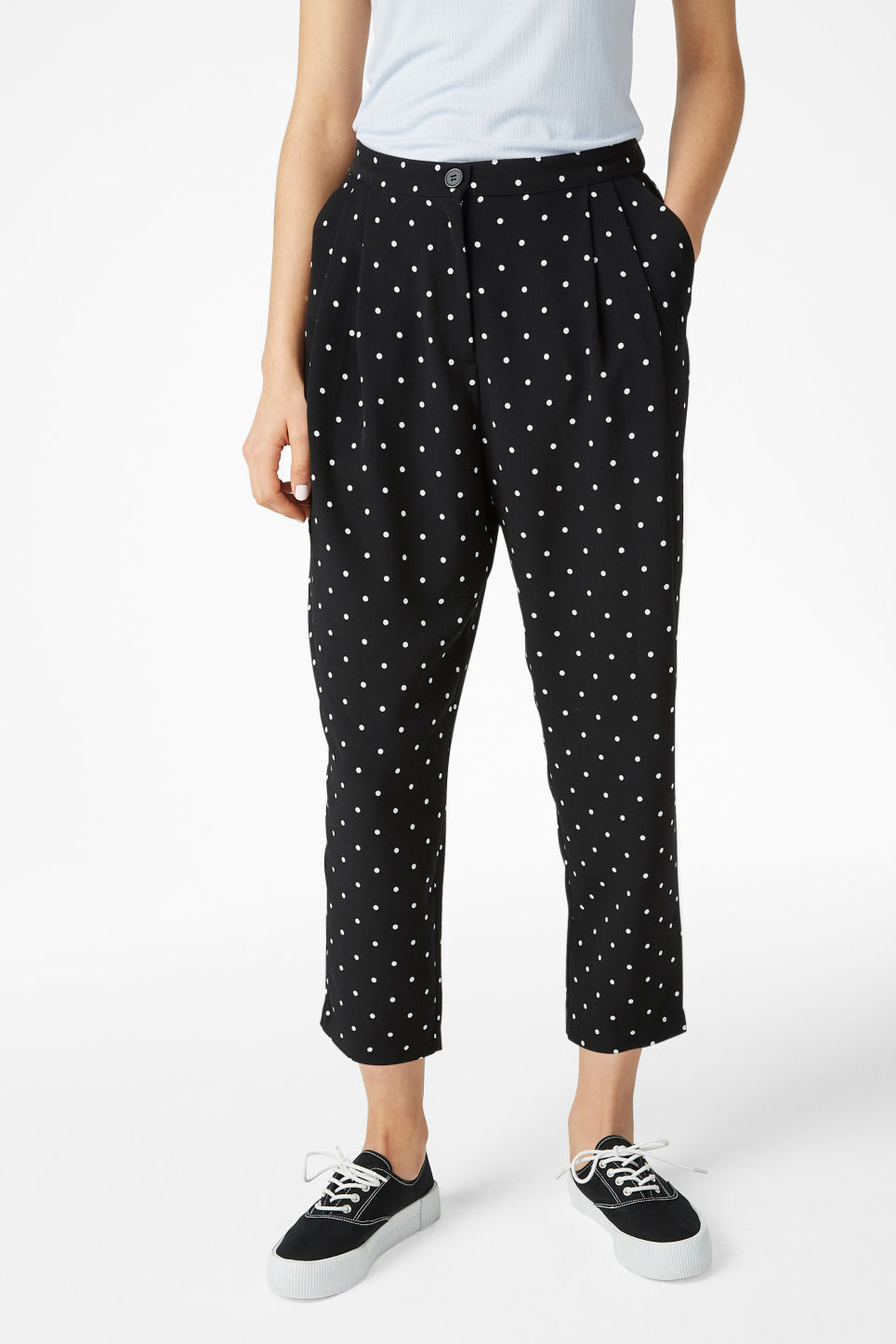 Model side image of Monki flowy trousers in black