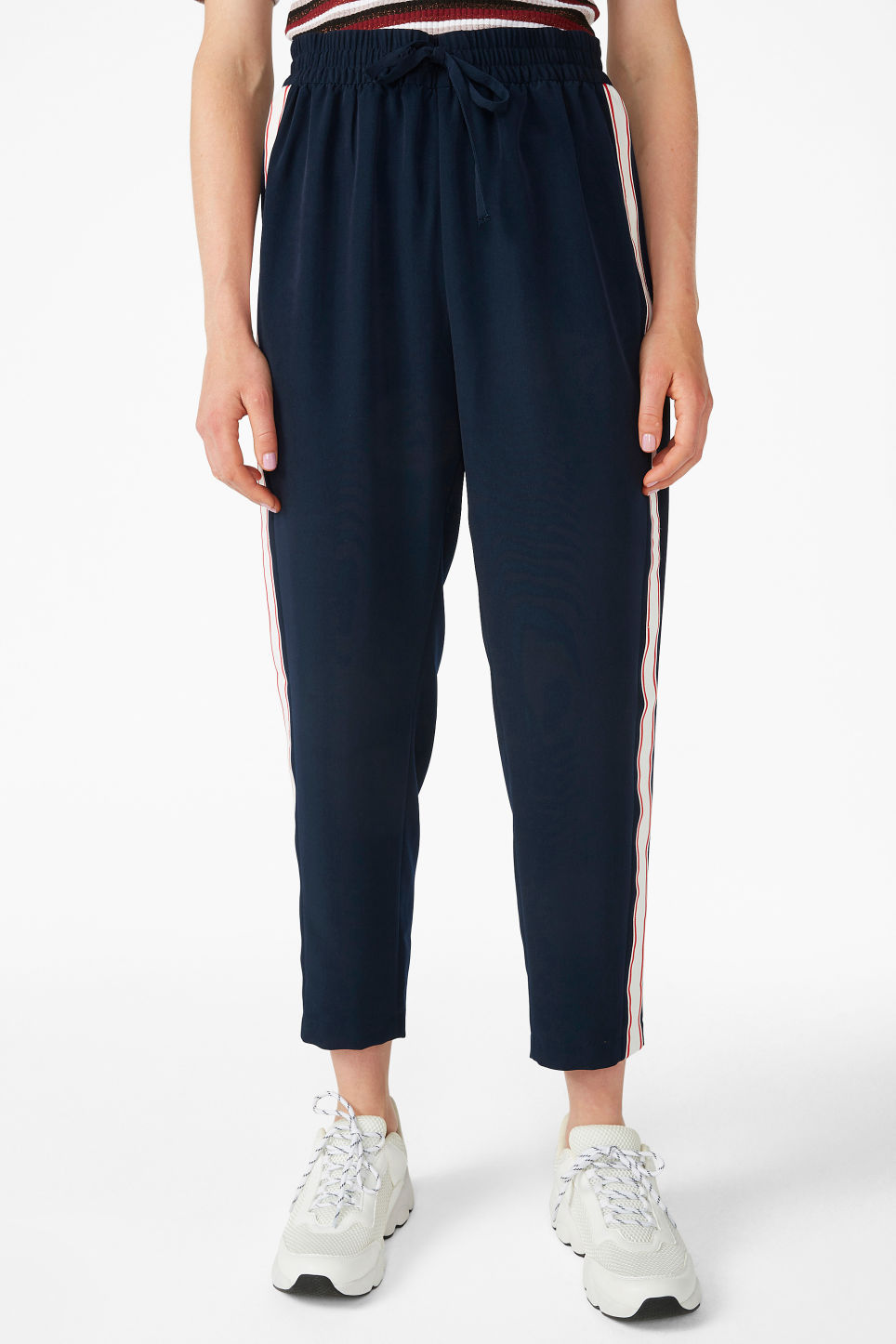 Model side image of Monki side stripe trousers in blue