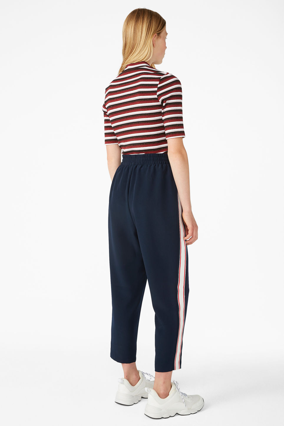 Model back image of Monki side stripe trousers in blue