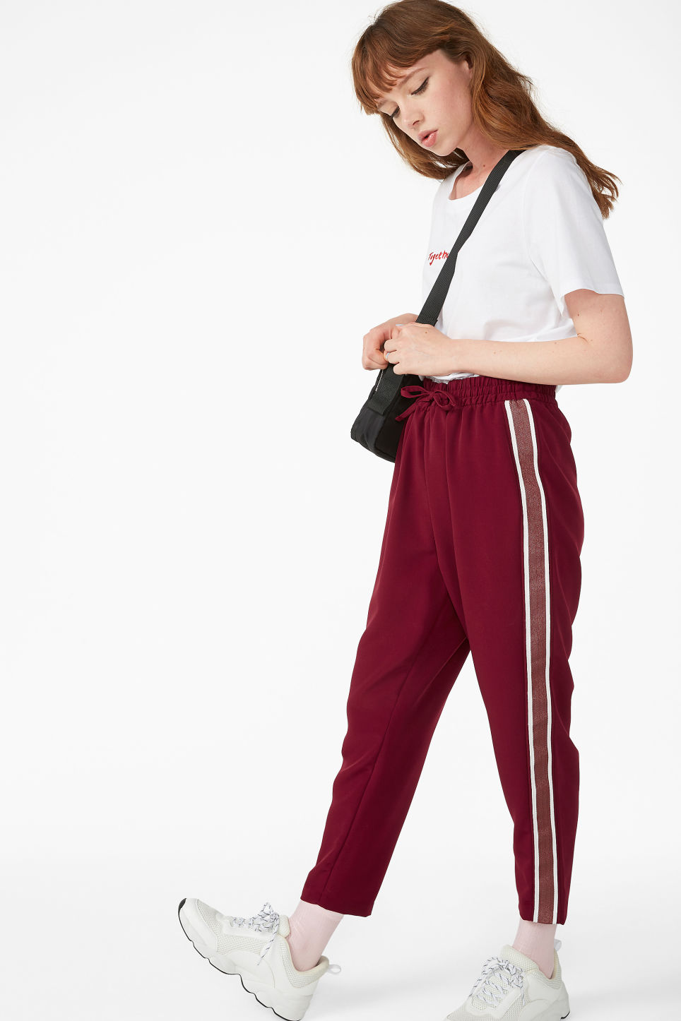 Model front image of Monki side stripe trousers in red