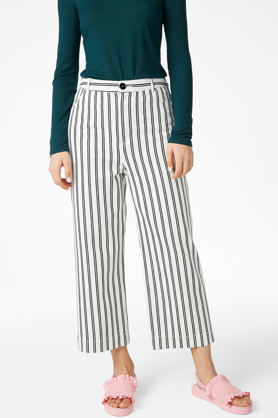 Model side image of Monki wide trousers in white