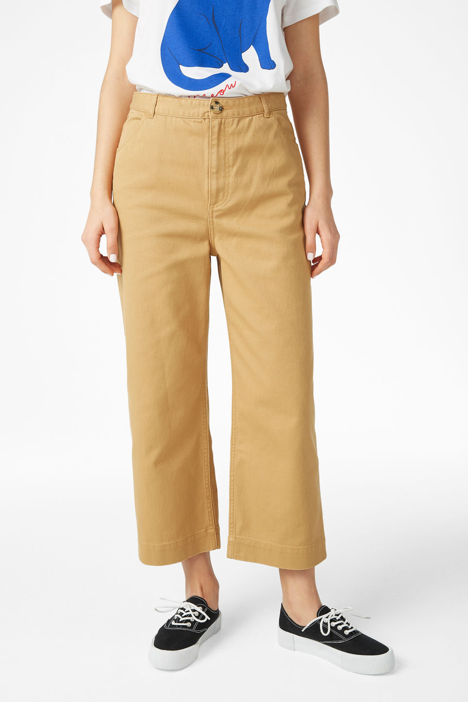 Model side image of Monki wide trousers in yellow