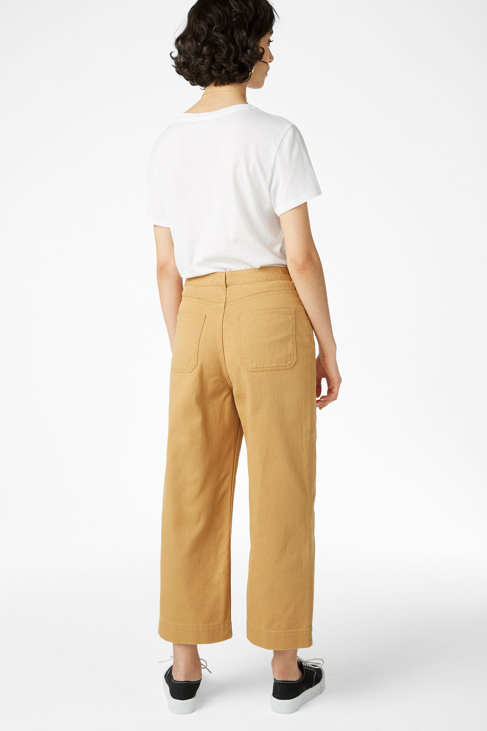 Model back image of Monki wide trousers in yellow