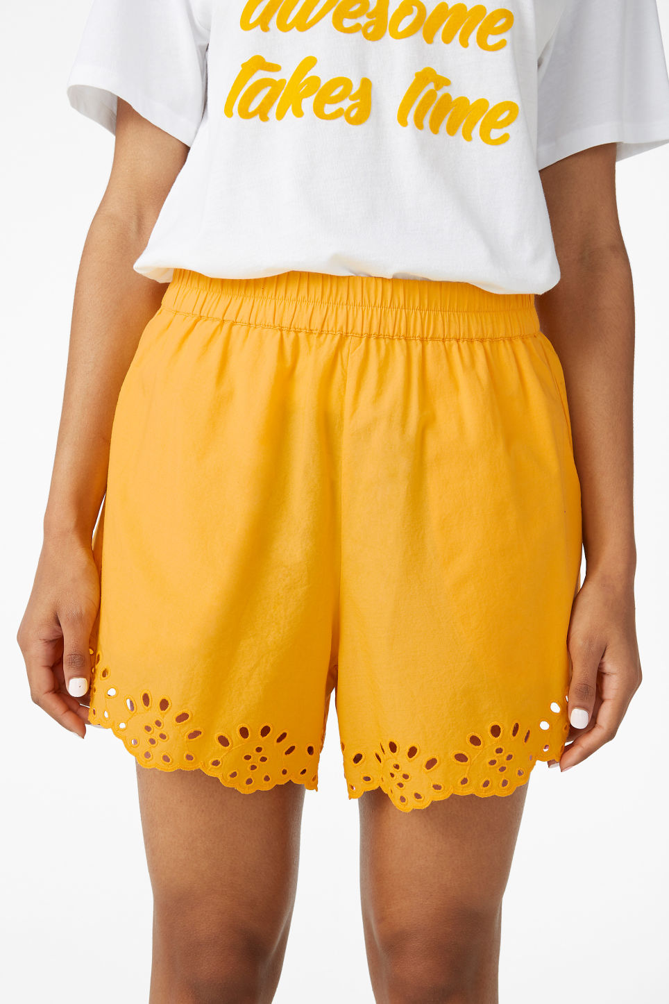 Model side image of Monki flowy shorts in yellow
