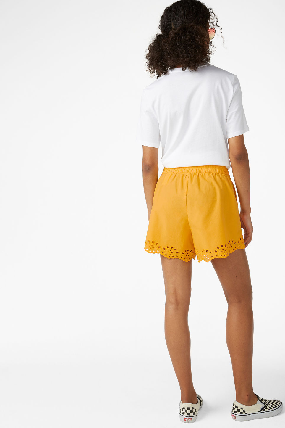 Model back image of Monki flowy shorts in yellow