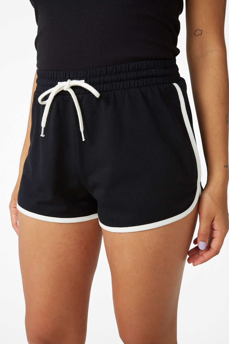 Model side image of Monki sporty shorts in black