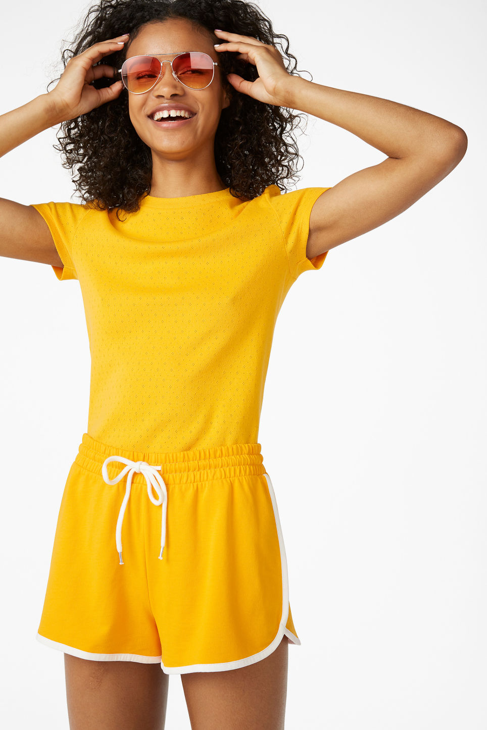Model front image of Monki sporty shorts in yellow
