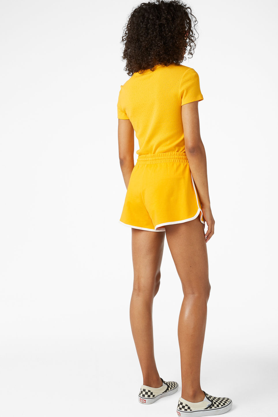 Model back image of Monki sporty shorts in yellow