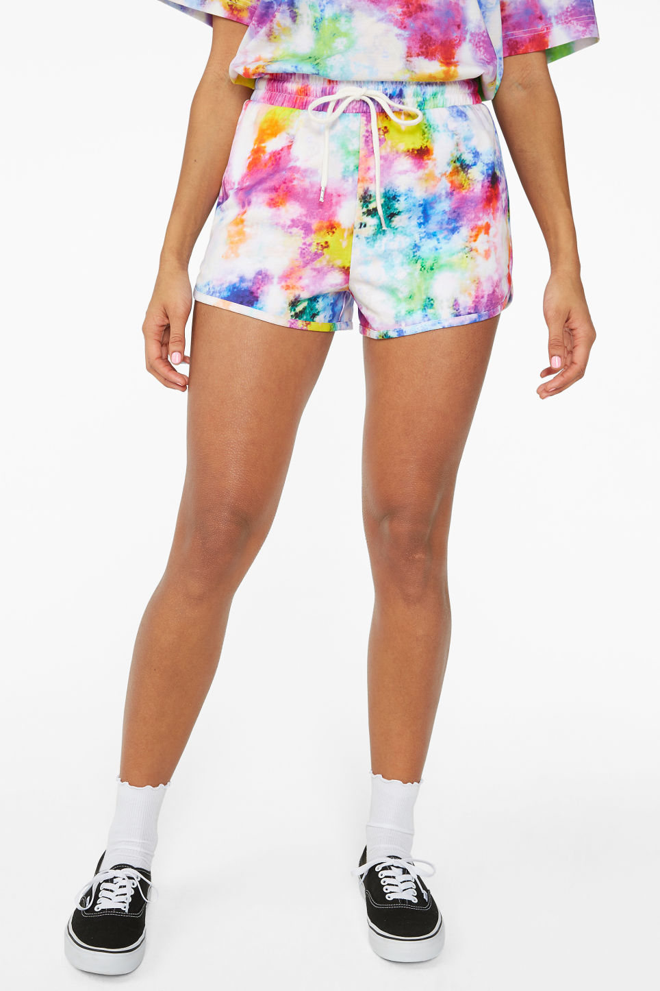 Model side image of Monki sporty shorts in white