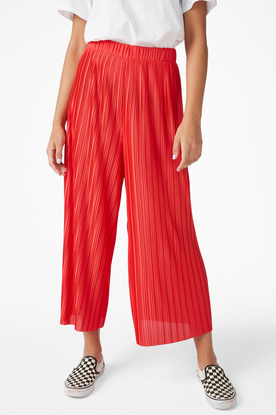 Model side image of Monki flowy trousers in red