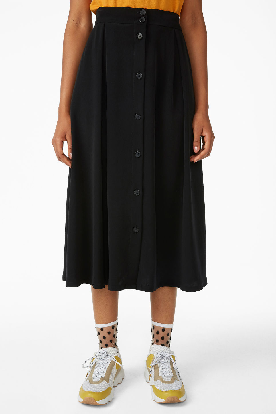 Model side image of Monki midi skirt in black
