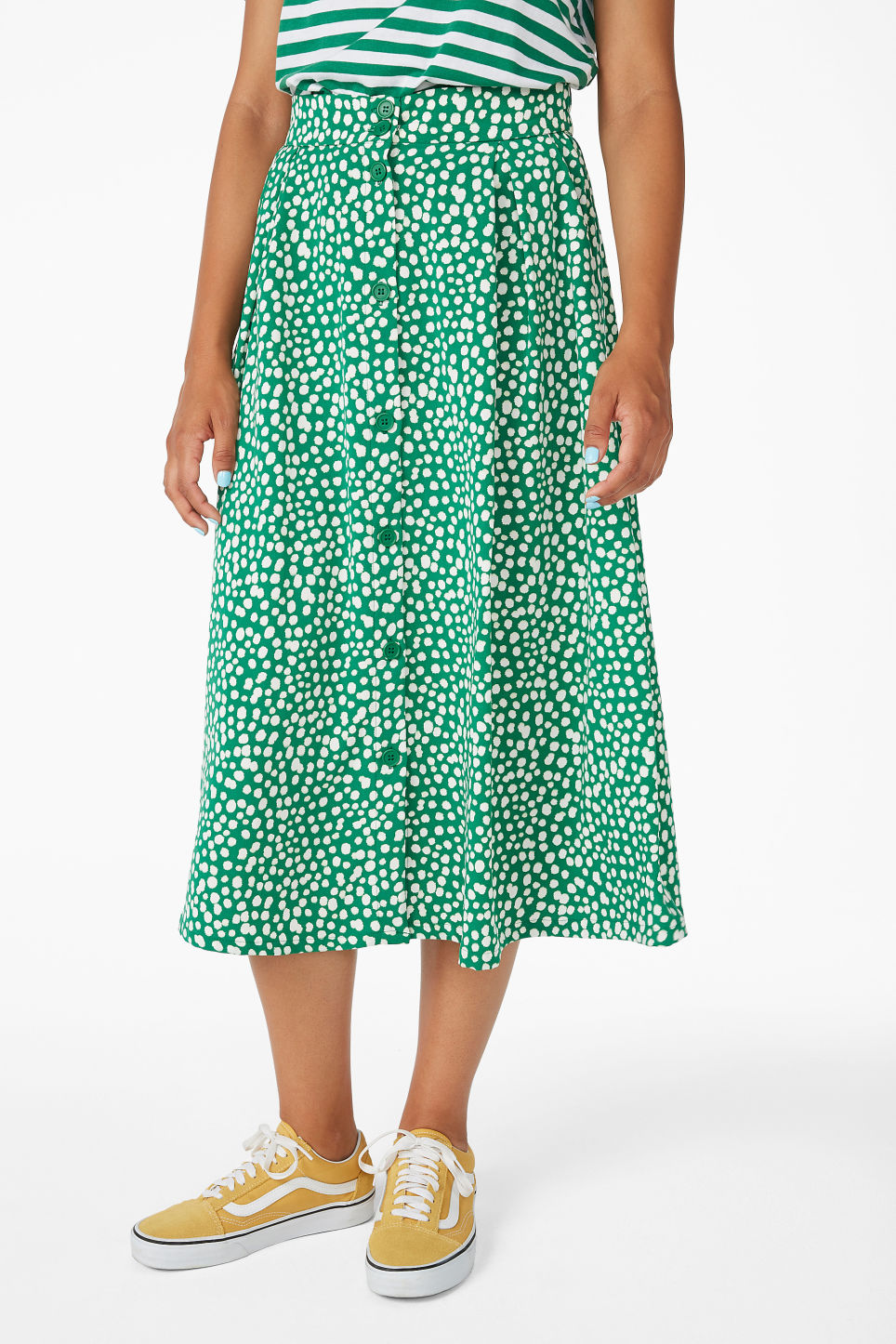 Model side image of Monki midi skirt in green