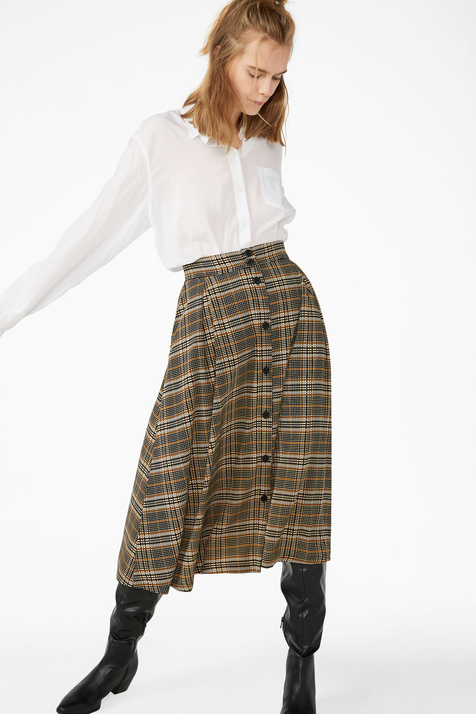 Model front image of Monki pleated midi skirt in beige