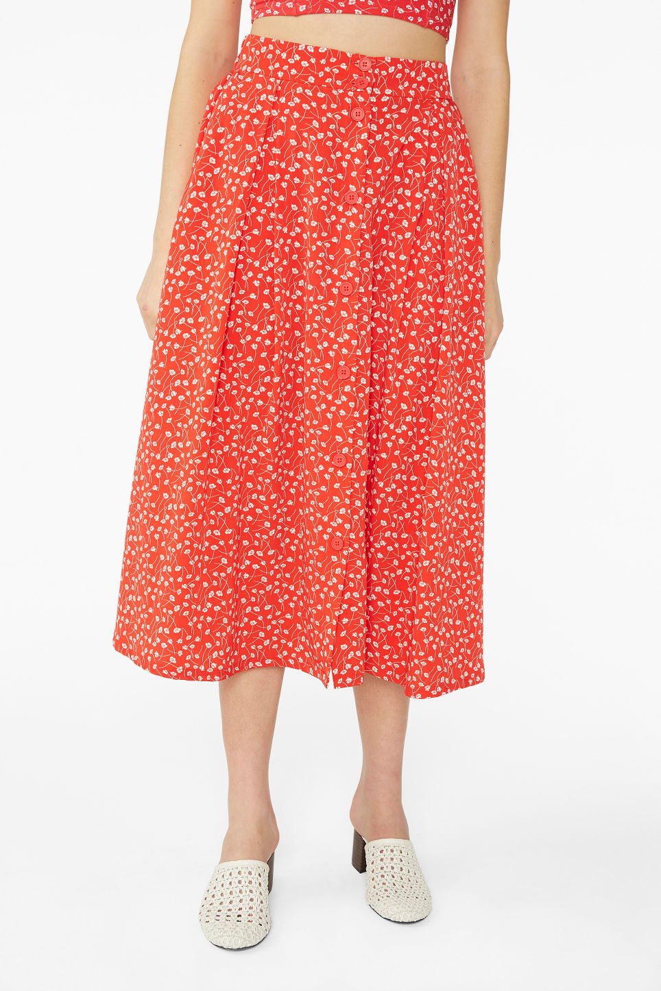 Model side image of Monki pleated midi skirt in red