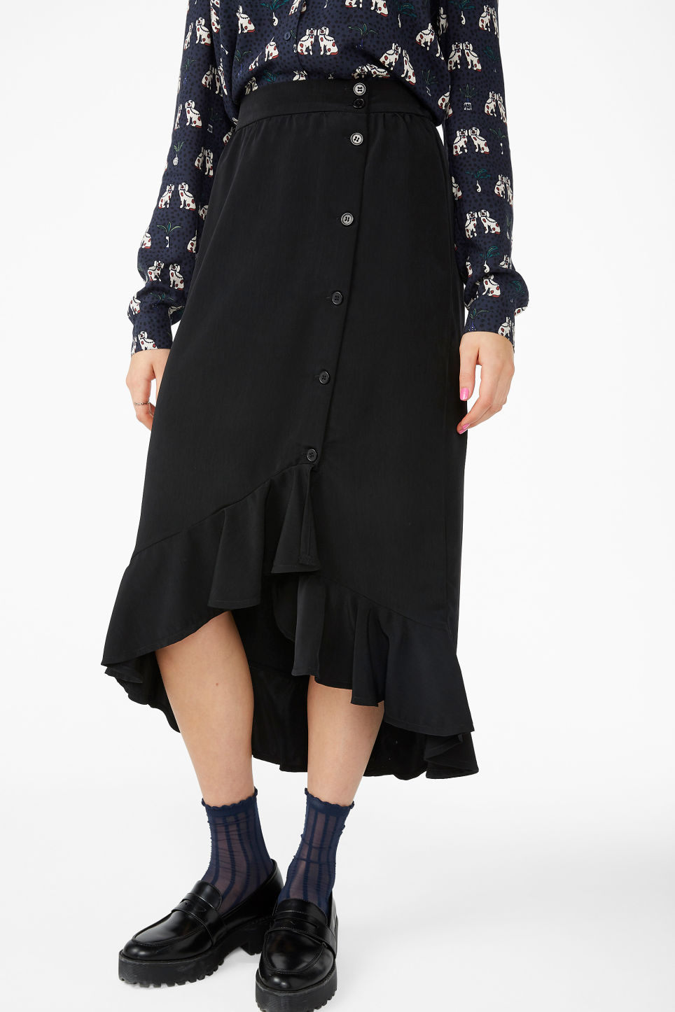 Model side image of Monki ruffle hem skirt  in black
