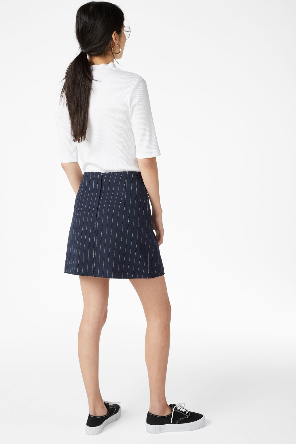 Model back image of Monki mini skirt in blue