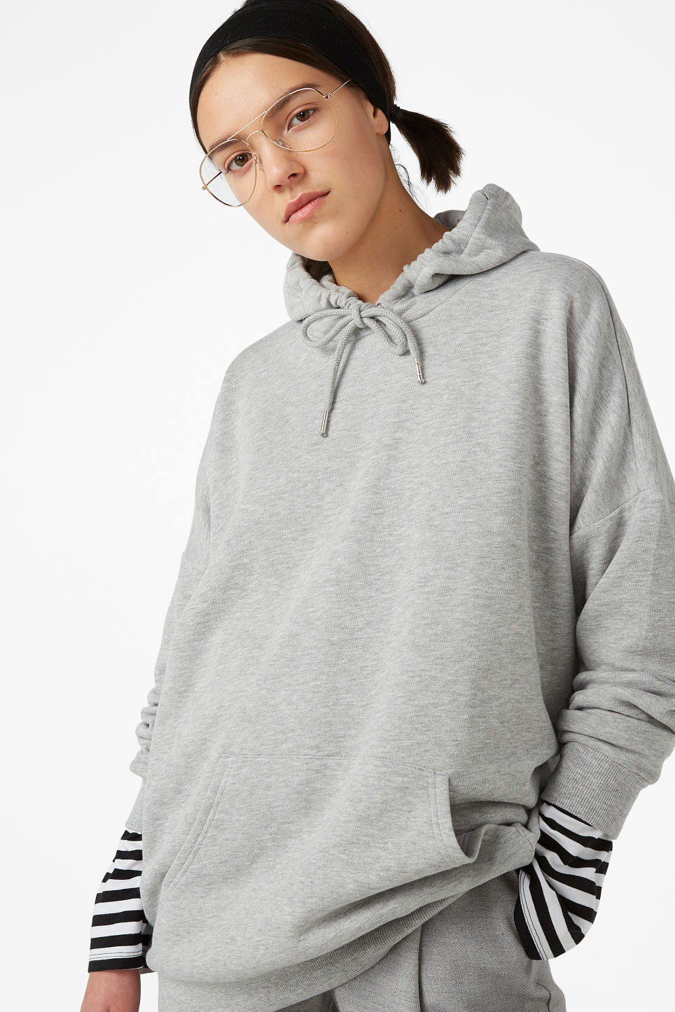 Model front image of Monki oversized hoodie in grey