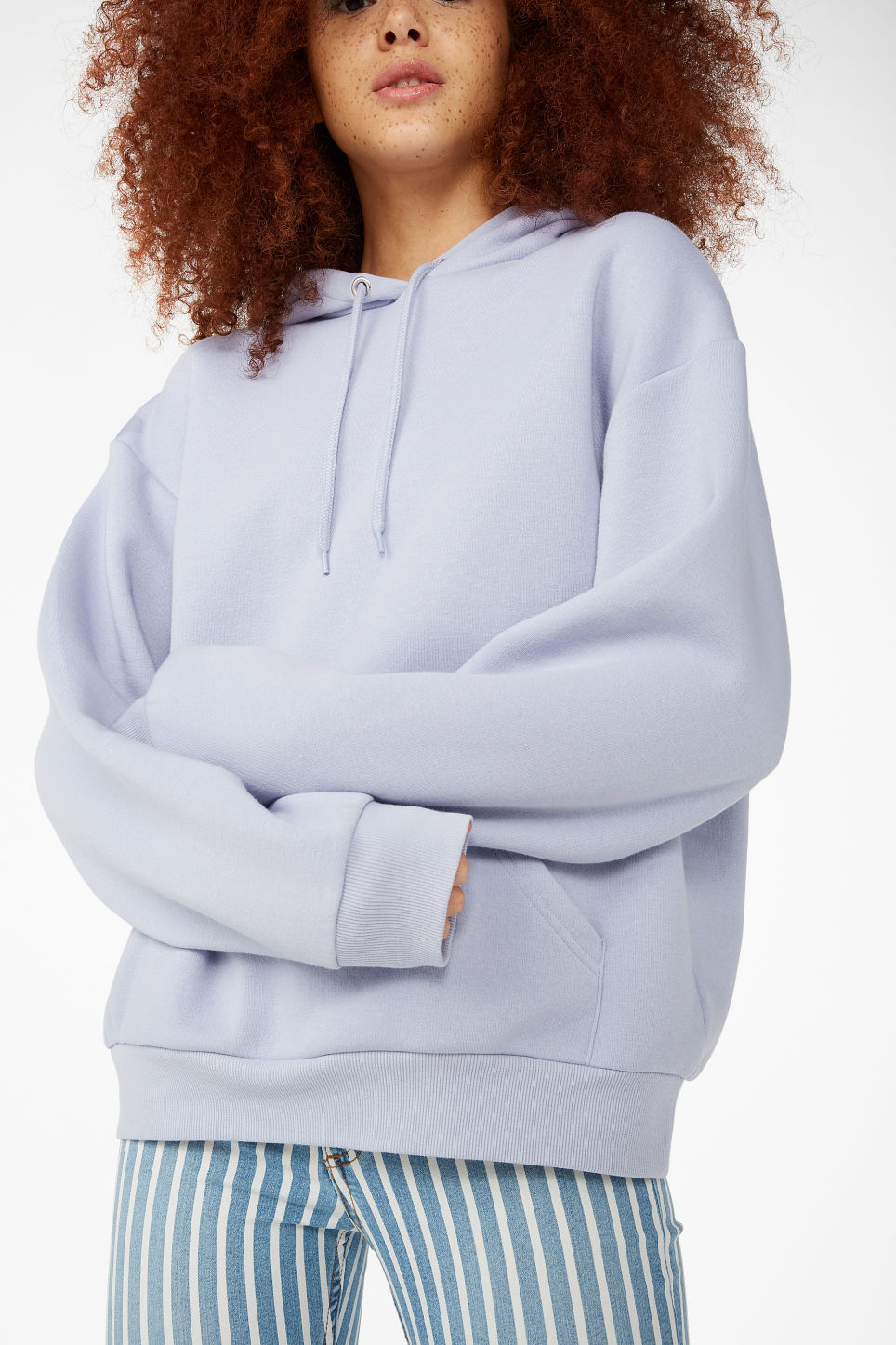 Model side image of Monki soft drawstring hoodie in purple
