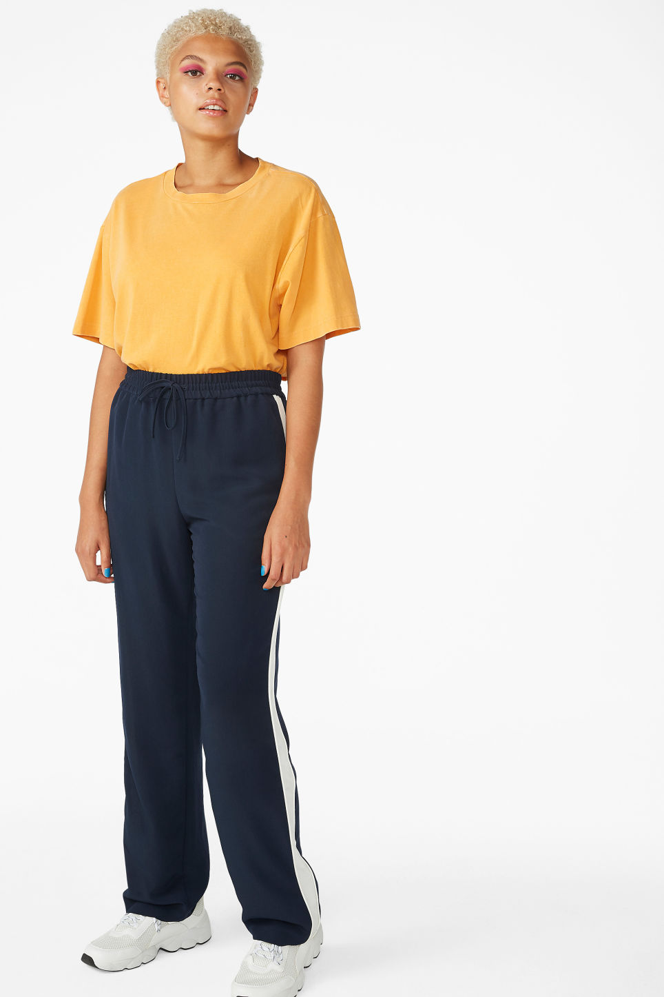 Model side image of Monki oversized tee in yellow