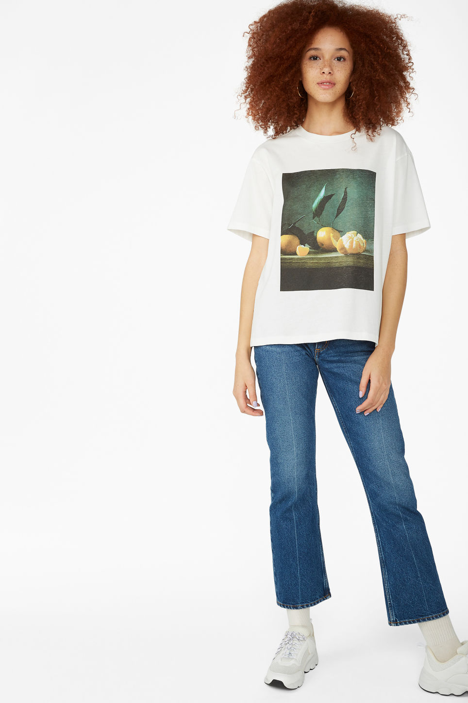 Model side image of Monki oversized tee in white