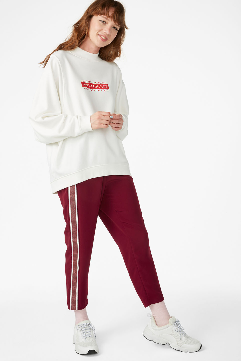 Model side image of Monki oversized sweater in white