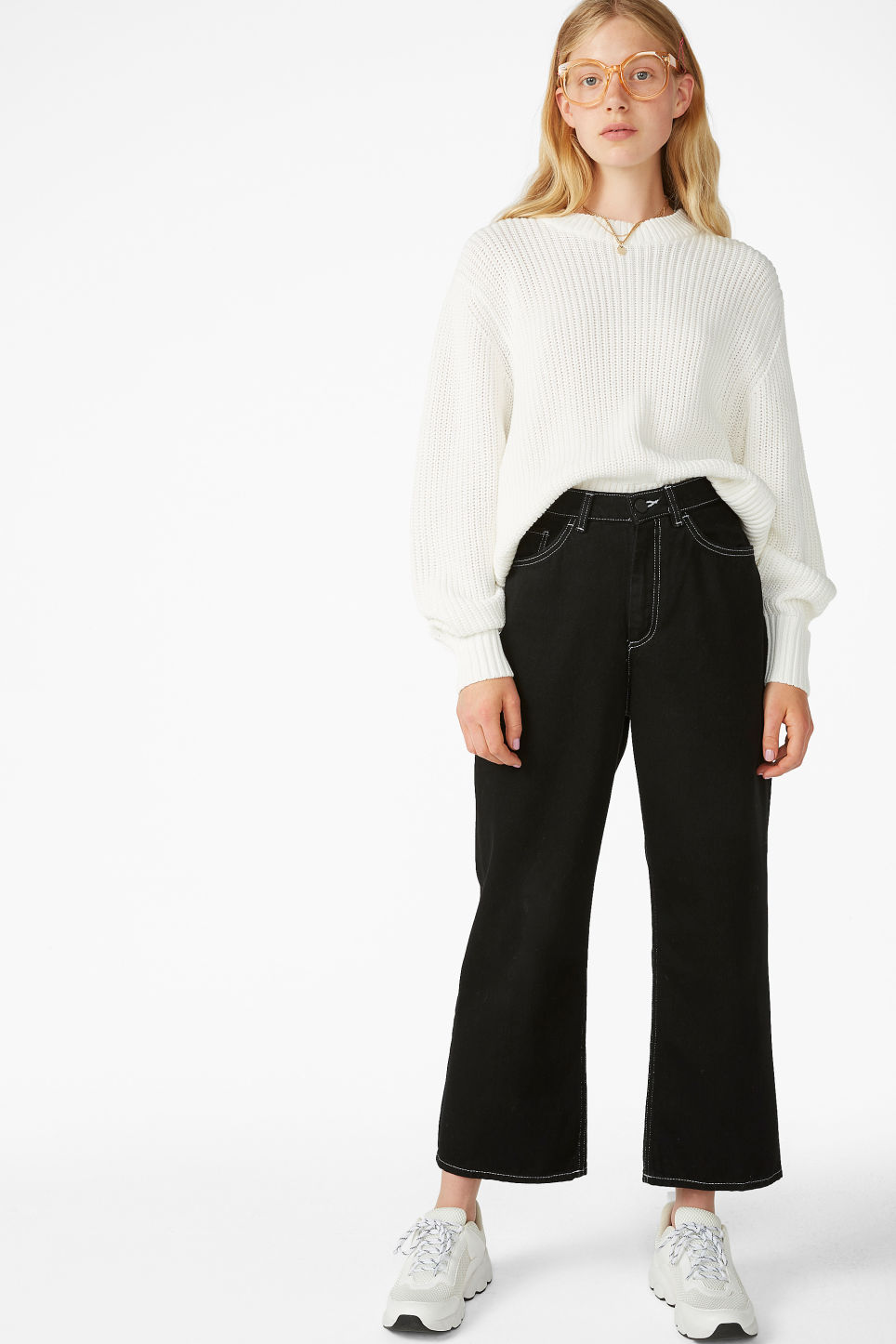Model side image of Monki puffed sleeve sweater in white