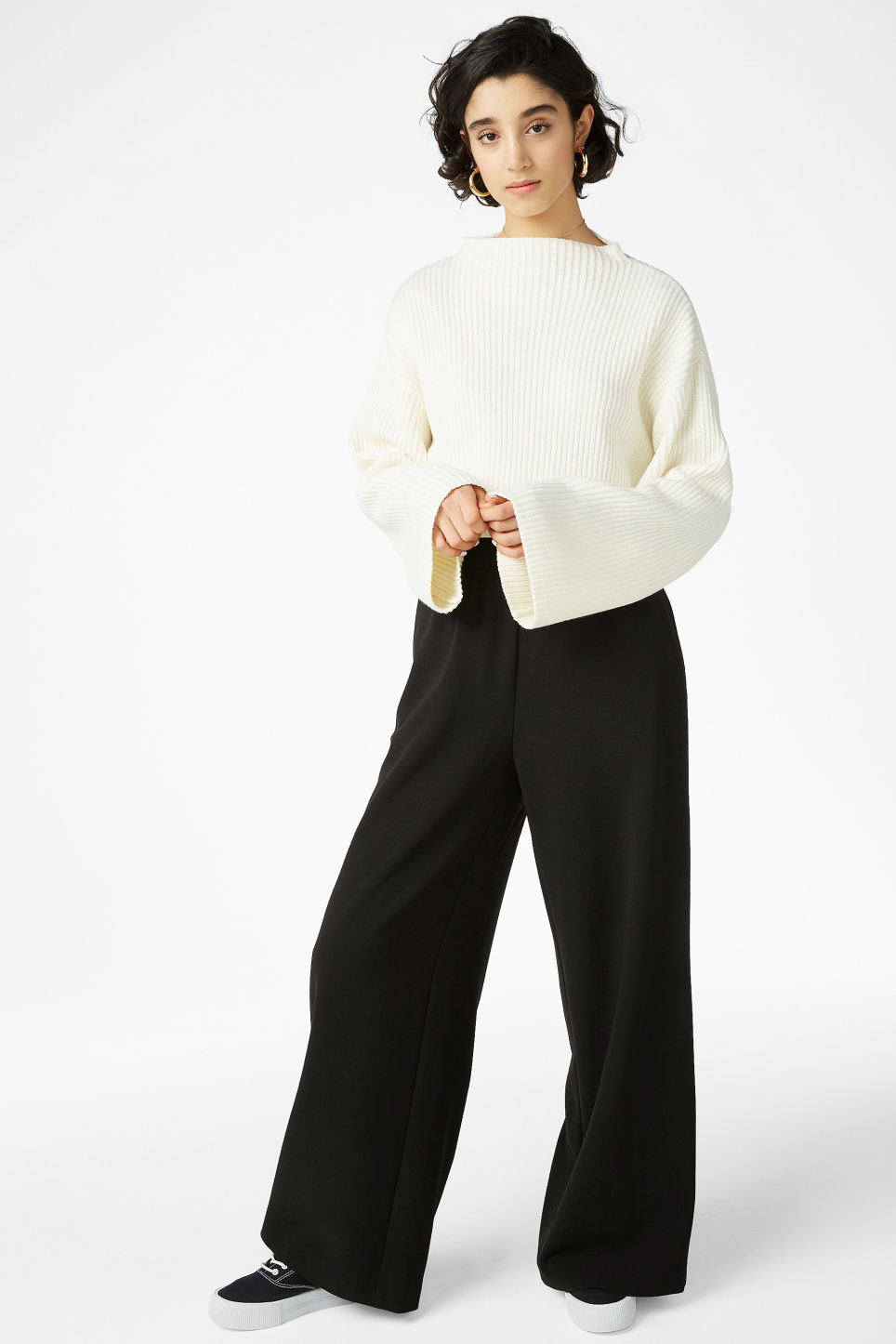 Model side image of Monki cropped knit sweater in white