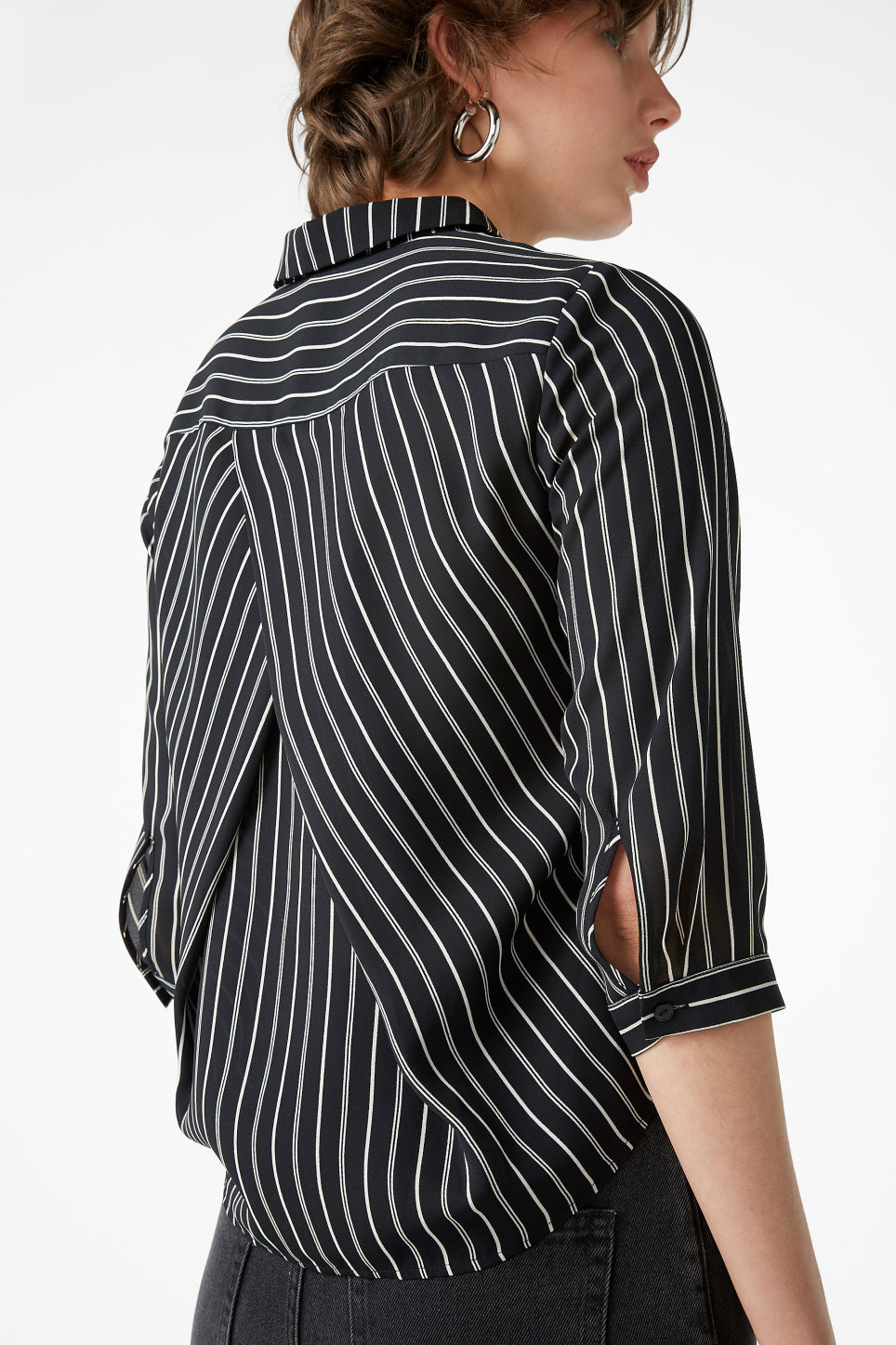 Model back image of Monki button up blouse in black