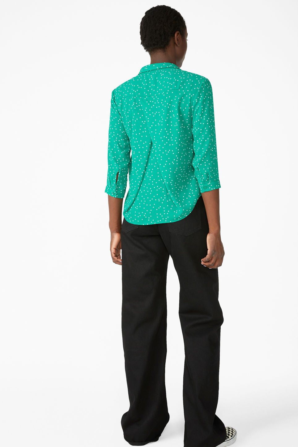 Model back image of Monki flowy pleat back blouse in green