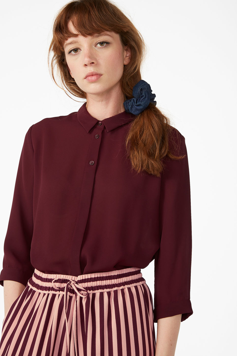 Model front image of Monki flowy pleat back blouse in red