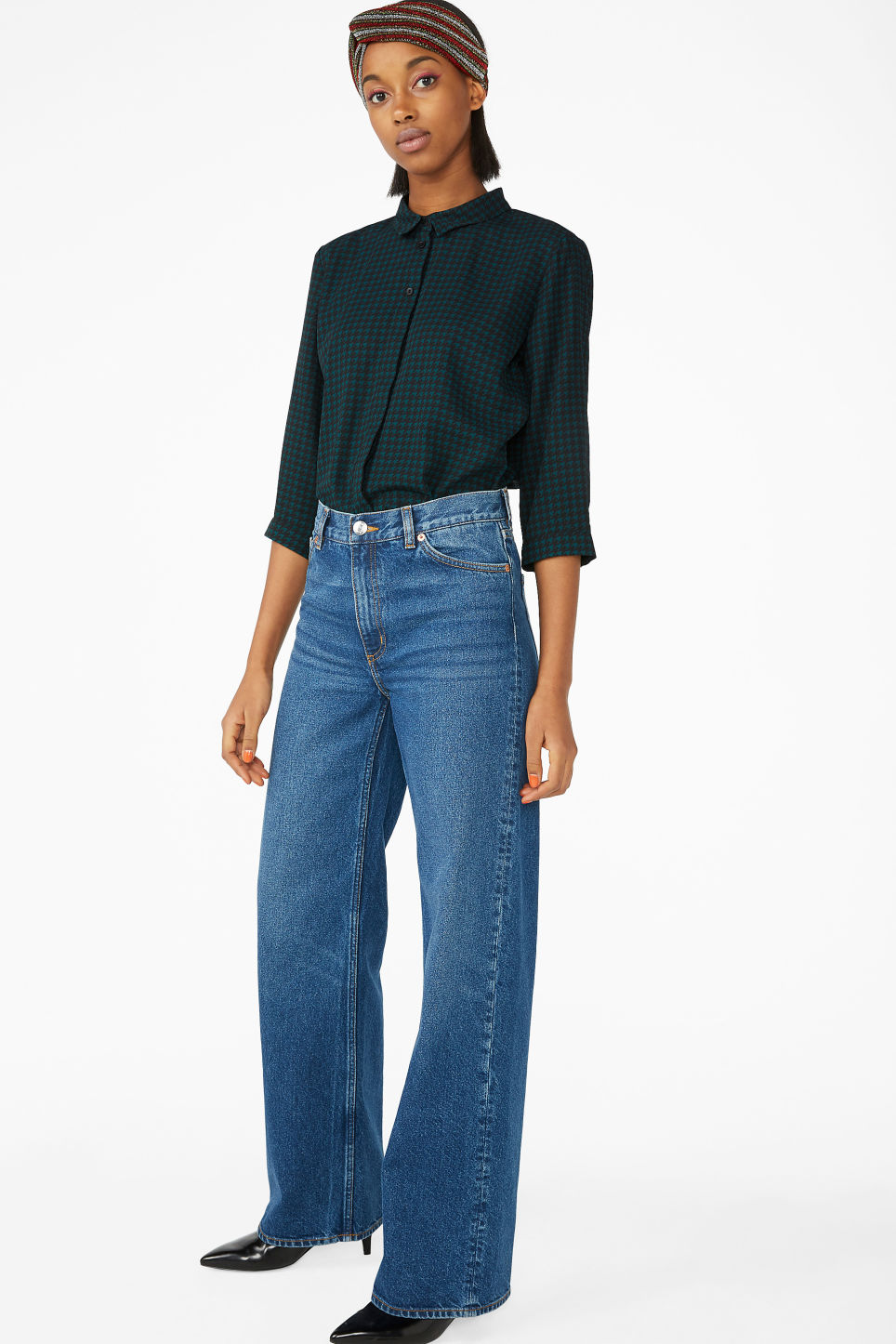 Model side image of Monki flowy pleat back blouse in green
