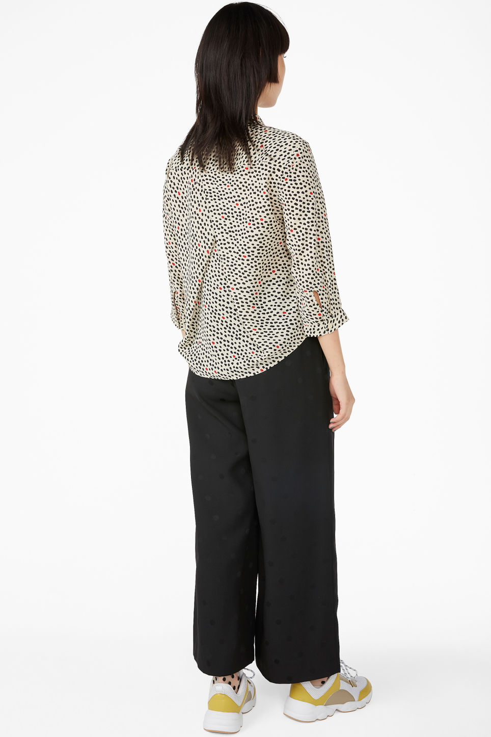 Model back image of Monki flowy pleat back blouse in beige