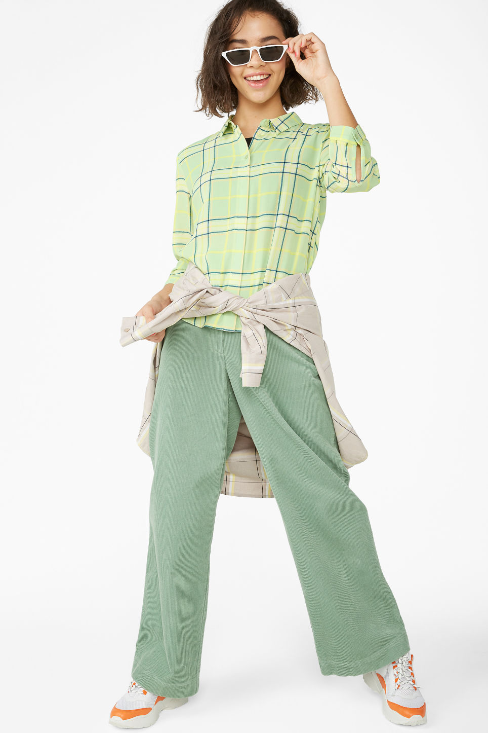 Model front image of Monki flowy pleat back blouse in green
