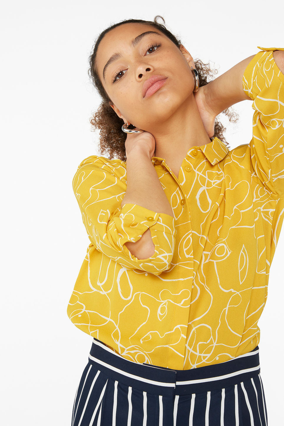 Model front image of Monki flowy pleat back blouse in yellow