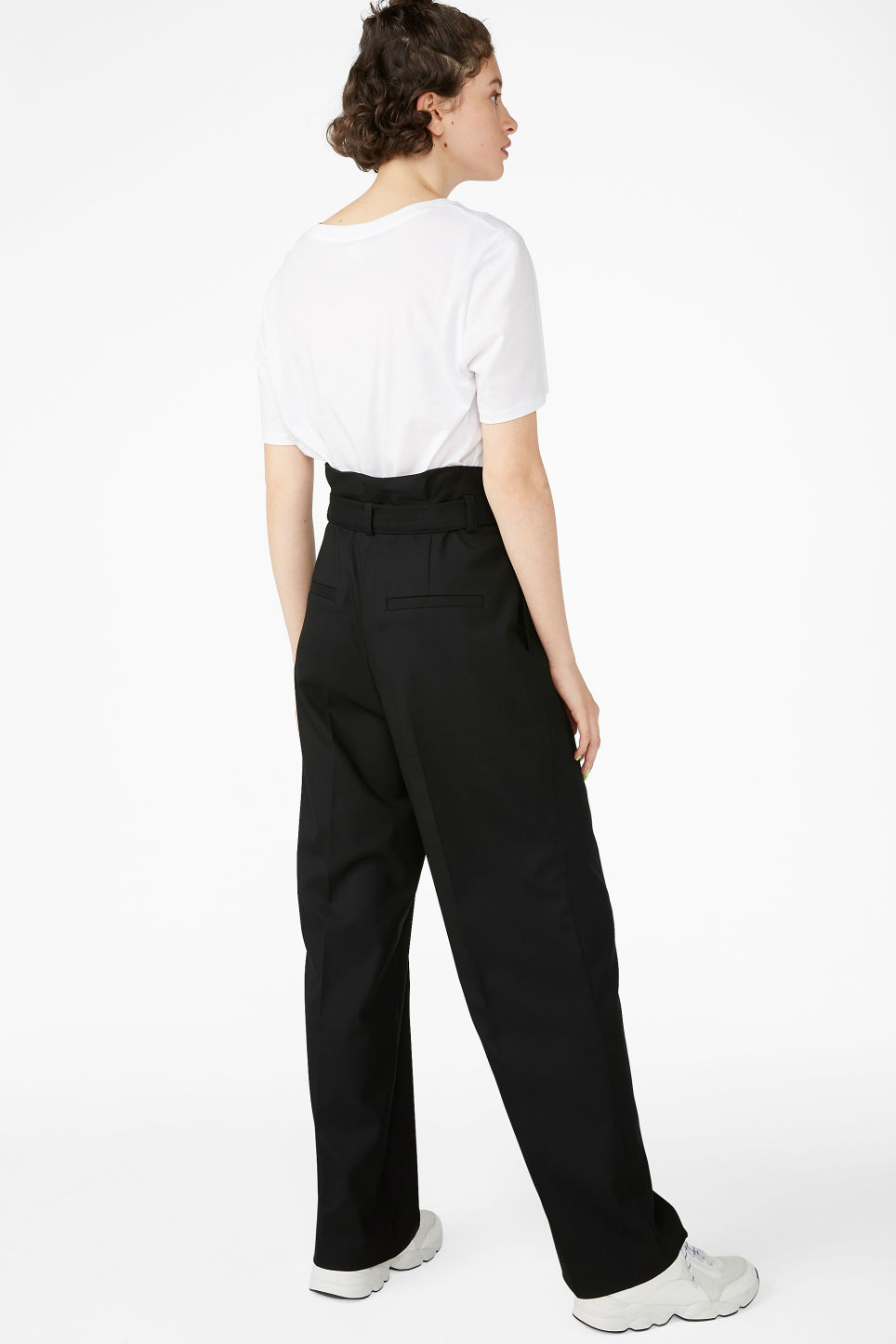 Model back image of Monki smart trousers with tie detail in black