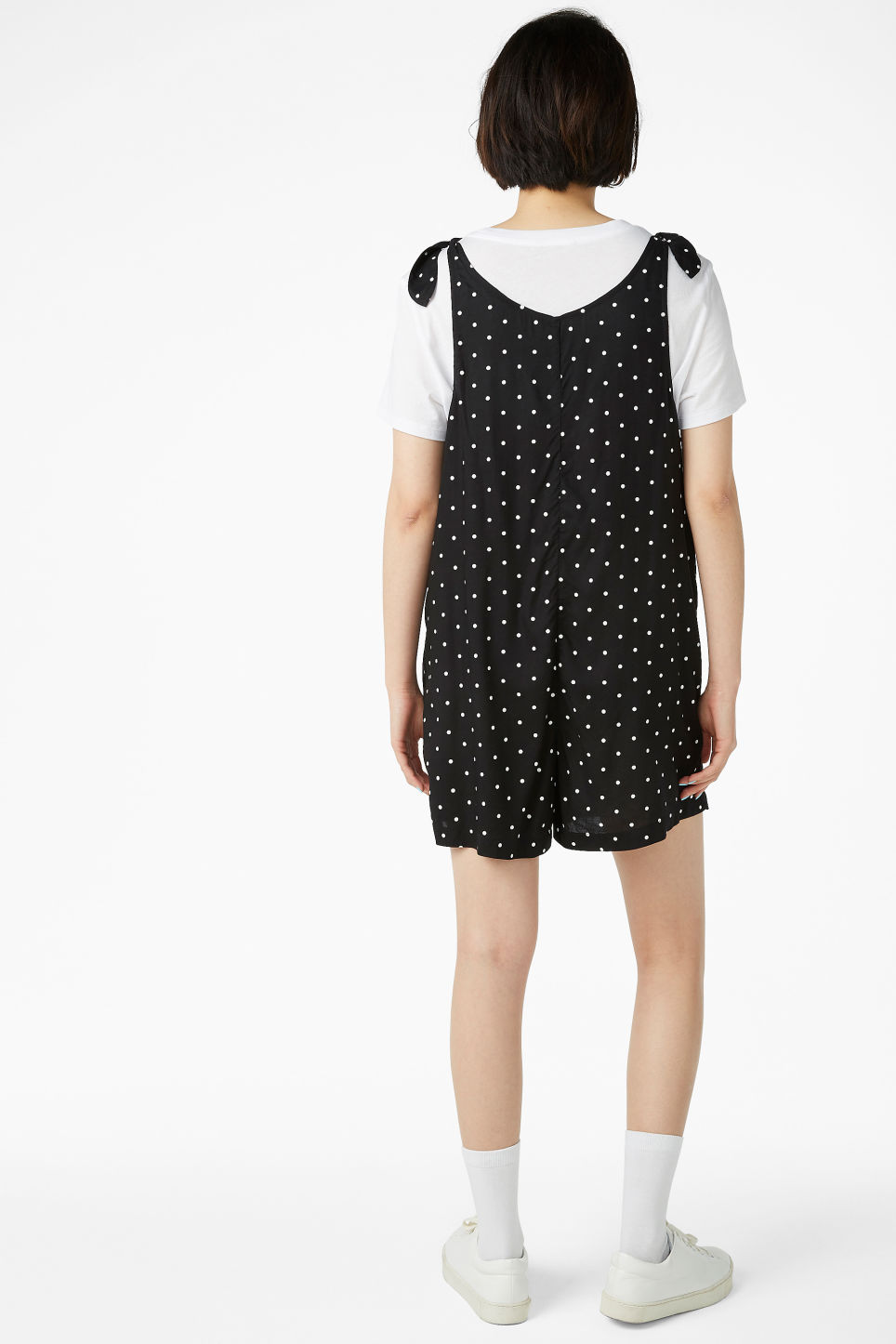 Model back image of Monki mini playsuit in black