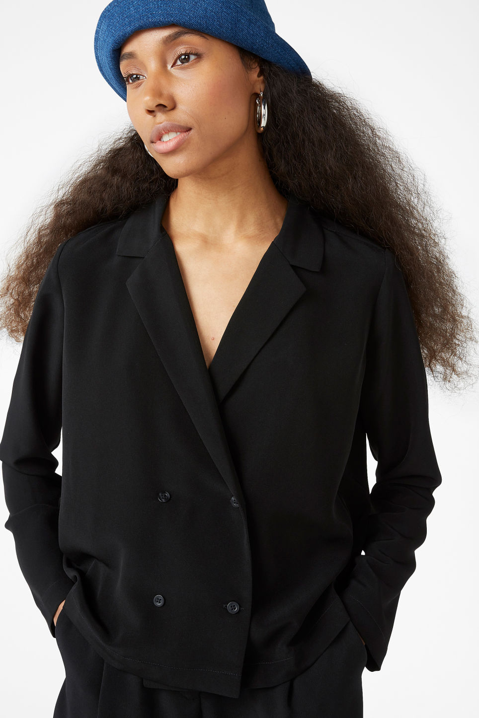 Model front image of Monki double-breasted blouse in black