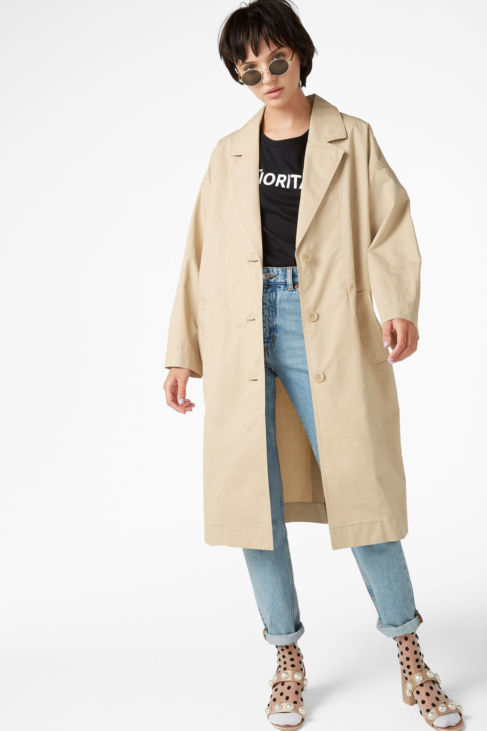 Model front image of Monki long coat in beige