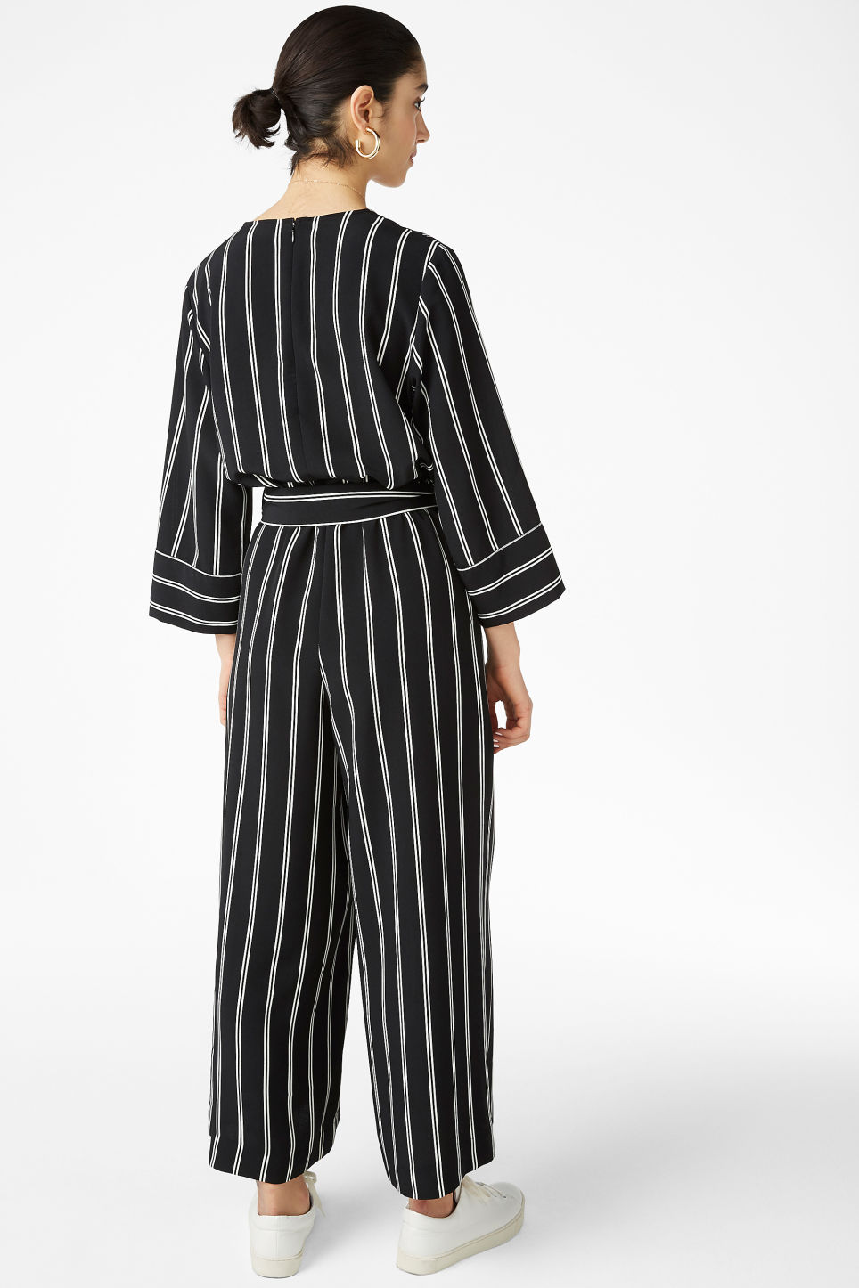 Model back image of Monki v-necked jumpsuit in black