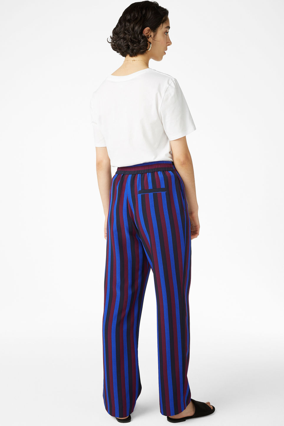 Model back image of Monki sporty trousers in blue