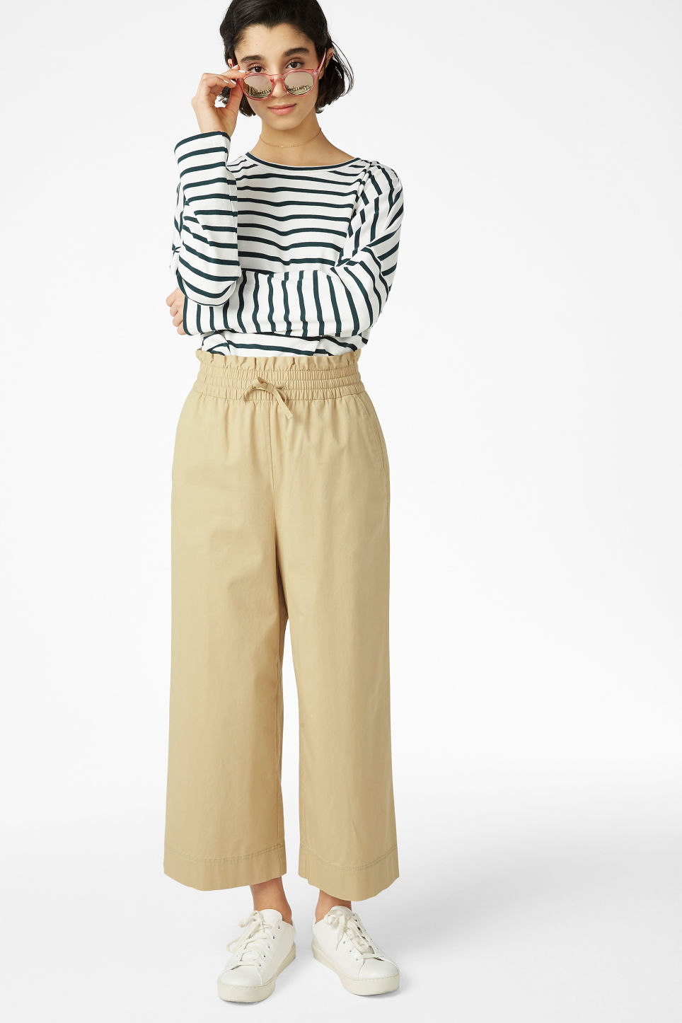 Model front image of Monki wide leg trousers in beige