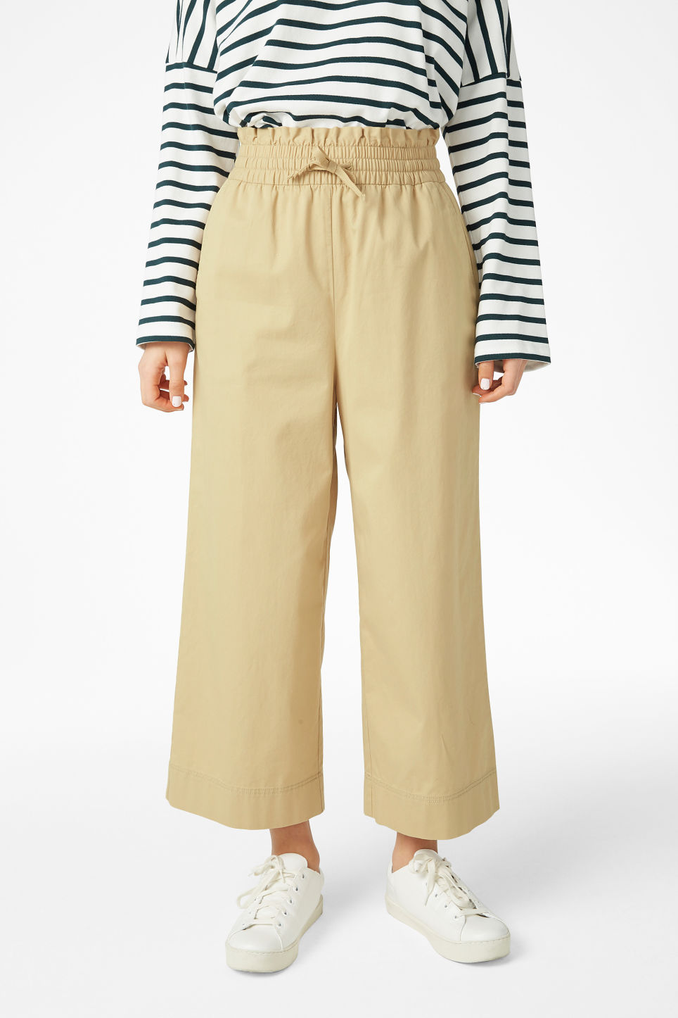 Model side image of Monki wide leg trousers in beige