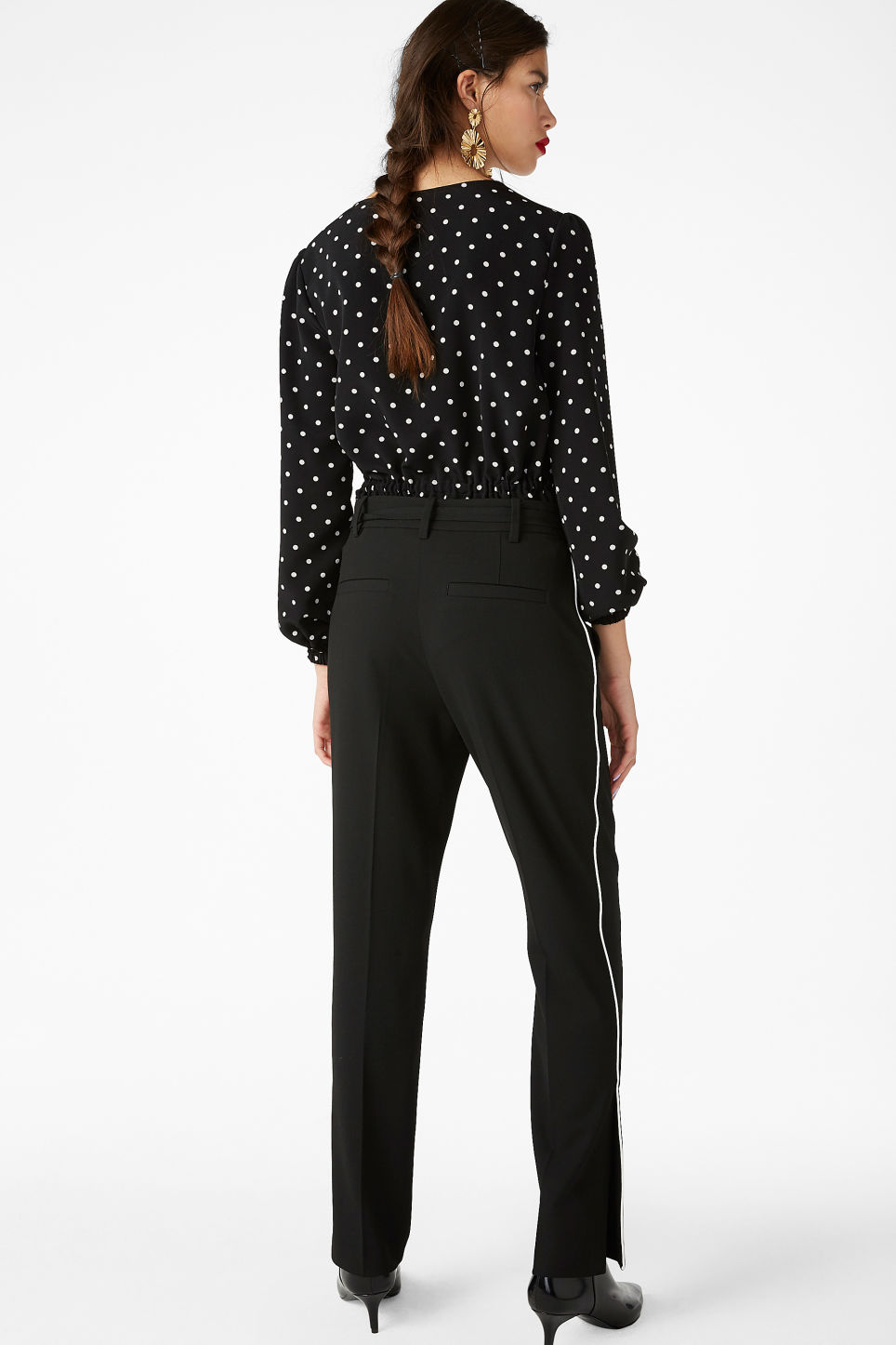 Model back image of Monki dressy slit trousers in black